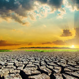 Natural disaster with drought earth and sunset Stock Image