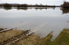 Natural disaster. Flooding of the Tisza river at Tiszalok, Hungary. Rut on the wet field Stock Photos