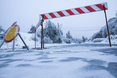 Natural disaster: road closed for ice with fallen trees in background due to heavy sleet Stock Photography