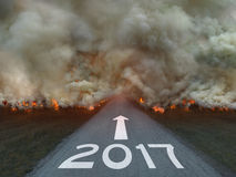 Natural disaster with 2017 sign on the road Royalty Free Stock Photos