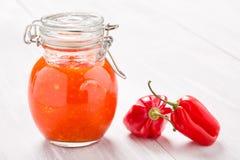 Natural diy habanero garlic sauce. Homemade DIY natural very hot pepper - habanero and garlic sauce on a beautiful wooden table Stock Images