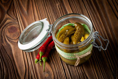 Natural diy pickles with chilli and garlic in a jar Royalty Free Stock Photo