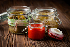 Natural diy pickles and hot chilli sauce Stock Image