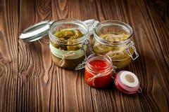 Natural diy pickles and hot chilli sauce Royalty Free Stock Photos