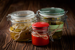 Natural diy pickles and hot chilli sauce Stock Photo