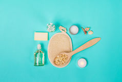 Natural domestic products for skincare. Oat, oil, soap, facial cleanser. Natural domestic products for skincare on a blue background. Oat, oil, soap, facial Royalty Free Stock Images