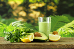 Natural drink a smoothie with avocado stock photos