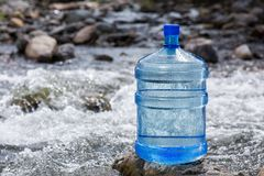 Natural drinking water in a large bottle. Natural mineral water in a large bottle Stock Images