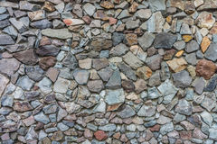 Natural dry stone wall for exterior decoration Stock Images