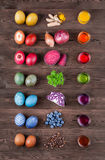 Natural dyed easter eggs. Natural easter eggs dyeing with natural dye color out of turmeric, onion, beetroot, parsley, red cabbage, blueberries, coffee Stock Images
