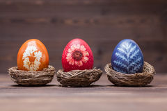 Natural dyed easter eggs. Easter eggs natural dyes with blossom leaves ornament Royalty Free Stock Photo