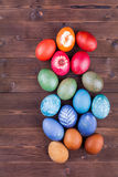 Natural dyed easter eggs on wood background. Colorful natural dyed easter eggs Royalty Free Stock Photo