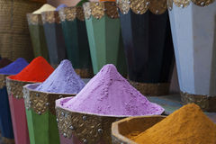 Natural dyes, colorful and vibrant pigment powders in wooden pots. Horizontal shot of colorful pigment powders in wooden pots used for wool painting in medina Royalty Free Stock Photos