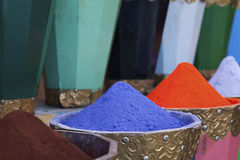 Natural dyes, colorful and vibrant pigment powders in wooden pots. Horizontal shot of colorful pigment powders in wooden pots used for wool painting in medina Stock Photo