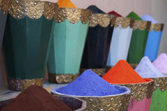 Natural dyes, colorful and vibrant pigment powders in wooden pots. Horizontal shot of colorful pigment powders in wooden pots used for wool painting in medina Stock Images