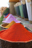 Natural dyes, colorful and vibrant pigment powders in wooden pots. Vertical shot of colorful pigment powders in wooden pots used for wool painting in medina souk royalty free stock photography