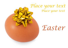 Natural easter egg with bow Royalty Free Stock Images