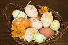 Natural easter egg variation. Easter egg variation with blossom in wooden basket on wooden background stock images