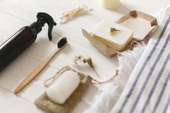 Natural eco bamboo toothbrush, coconut soap, handmade detergent, crystal deodorant, bamboo ear sticks on towel, bathroom. Essentials in sustainable lifestyle royalty free stock photo