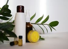 Natural eco cosmetics. Jars without labels, bubbles, oils, flowers royalty free stock photography