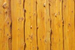 Natural edge wood wall cedar plank rough wooden house. Live edge wood wall natural planks rough pine stock photography