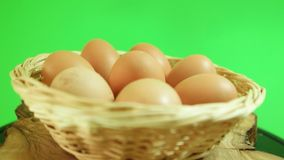 Natural eggs rotating in basket with green screen background. Natural eggs rotating in basket stock video