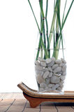 Natural Elements. Bamboo and grasses in a white stone filled vase set upon an asian style tray Stock Photography