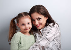 Natural emotional beautiful mother and adorable kid girl hugging Royalty Free Stock Photography