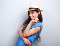 Natural emotional laughing woman posing in summer hat on blue ba. Ckground Stock Photography