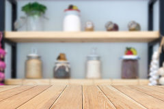 Natural  empty pattern wooden table with blurred kitchen, various. Natural empty pattern wooden table with blurred kitchen, various food ingredients and utensils Royalty Free Stock Photo