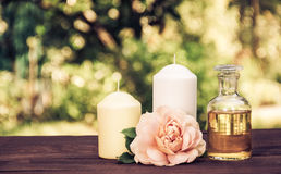 Natural essential oil, fragrant roses and candles. Spa concept. Romantic concept. Copy space. Natural essential oil, fragrant roses and candles. Spa concept Royalty Free Stock Photos