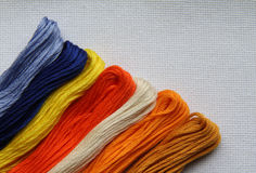 Natural fabric with embroidery floss. Natural linen fabric for embroidery (white) with embroidery floss Stock Image