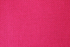 Natural fabric. Natural linen fabric for embroidery (red Royalty Free Stock Photography