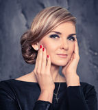 Natural fashionable beauty of a woman face. Black dress Royalty Free Stock Image