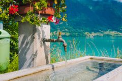 Natural faucet on the way to Interlaken town Royalty Free Stock Photography