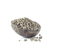 Natural fertilizer in coconut shell on white Royalty Free Stock Photography