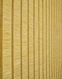Natural fibers - rhythmic background. Natural fibers bonded by weaving transverse threads to form a flat fabric with contrasting cross lines and rhythmic stock photo