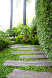 Natural flagstone path landscaping in home garden Royalty Free Stock Photos