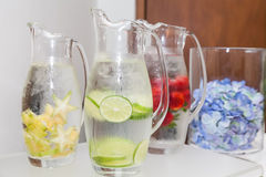 Natural flavored jugs with water royalty free stock photos