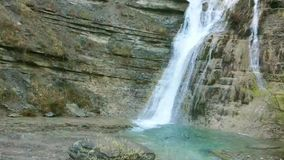 Natural Flowing Waterfall. A natural Flowing high Waterfall, this being located in Tuscany Italy stock video footage