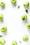 Natural food design with green apples frame white desk background top view mock up Royalty Free Stock Images