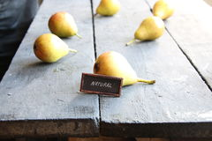 Natural food idea. Juicy flavorful pears and tag. Natural food idea, Juicy flavorful pears on a wooden table Royalty Free Stock Photos