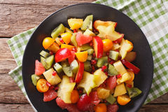 Natural Food: Salad of fresh exotic tropical fruits close-up on Royalty Free Stock Photos