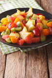 Natural Food: Salad of fresh exotic tropical fruits close-up on Royalty Free Stock Photography