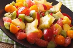 Natural Food: Salad of fresh exotic tropical fruits macro on a p. Salad of fresh exotic tropical fruits macro on a plate on the table. Horizontal Royalty Free Stock Photos