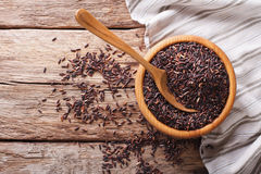 Natural Foods: Raw wild black rice close up in a wooden bowl. Ho Stock Photos