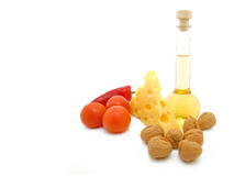 Natural form foods. Cheese, oil, nut and  tomato. Stock Photos