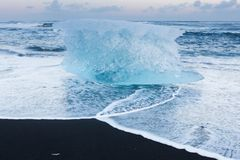 Natural freezing iceberg over black sand beach, Iceland Stock Photo