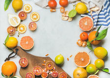 Natural fresh citrus fruits over grey marble table background Royalty Free Stock Photo