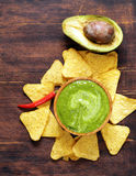 Natural fresh guacamole dip with avocado and chips Royalty Free Stock Image